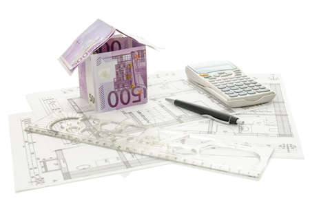 House made of 500 Euro money on an architectural building plan. Isolated on a white background. photo