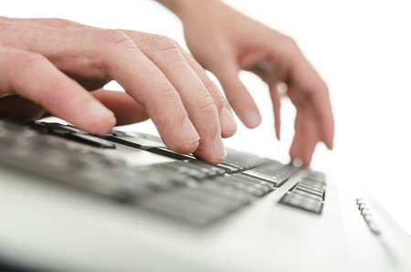 Detail of businessman hands typing on computer keyboard  Over white background  photo