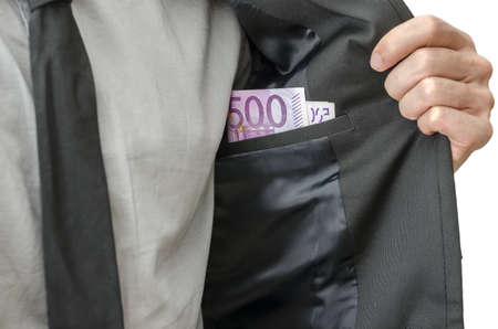 Businessman showing money in inner pocket of his suit  Concept of corrupted businessman  photo