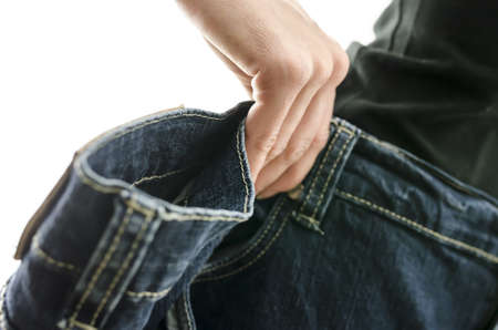 oversized: Detail of woman skinny waist in too large old jeans  Concept of successful dieting  Shallow dof