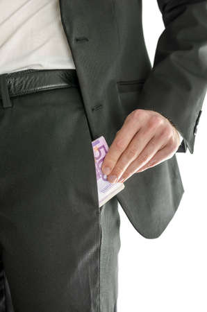 abusing: Front view of a businessman putting large amount of money in his pants pocket