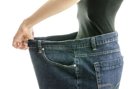 Side view of skinny woman in too large jeans  Concept of successful weight loss  photo