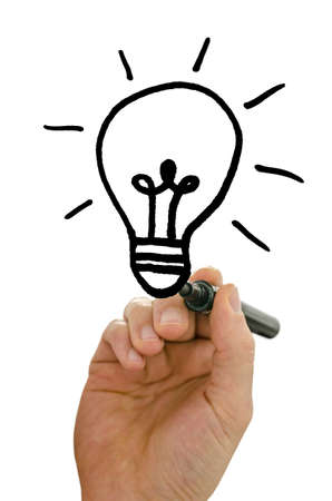 Close up of male hand drawing light bulb on a virtual screen with black marker  Over white background  Stock Photo