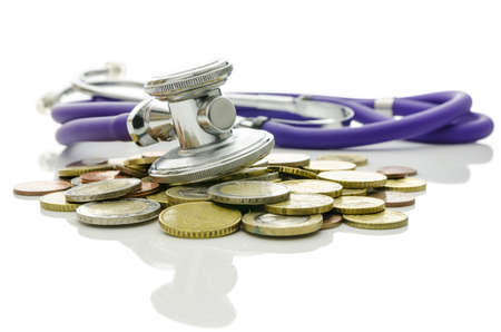Concept of financial crisis recovery  Stethoscope on euro coins representing help and hope for the market  Stock Photo - 19088317