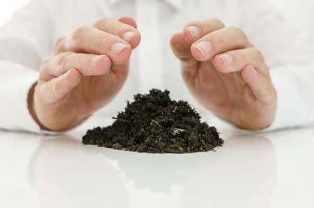 chi healer: Male hands healing soil with  energy. Stock Photo
