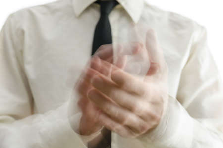 adulation: Close up of businessman blurred hands clapping.