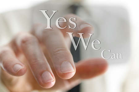 Male finger pointing at a Yes we can sign on a virtual screen  photo