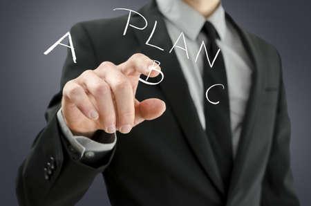 Detail of businessman hand choosing plan B on a virtual screen  photo
