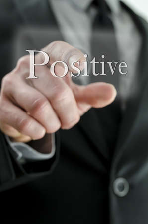 Detail of male finger pushing Positive button on a touch screen interface. Stock Photo - 19324879