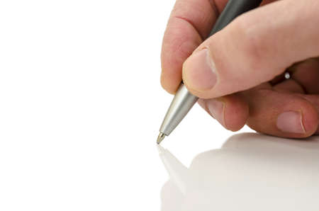Detail of businessman hand holding a pen on a white table with reflection  photo