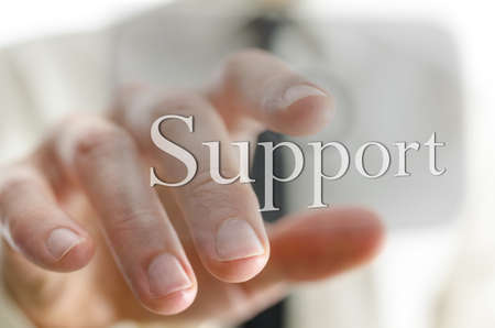 helpline: Male hand pointing at Support icon on a virtual screen  Representing customer support service