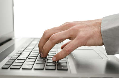 Detail of business man hand using laptop  Isolated over white background  photo