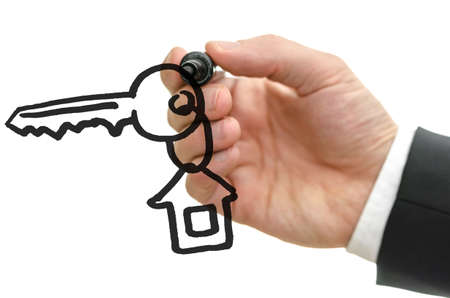 vision concept: Detail of male hand drawing house key with key chain o a virtual whiteboard