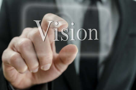 prospect: Close up of business man hand pressing Vision button on a touch screen interface.