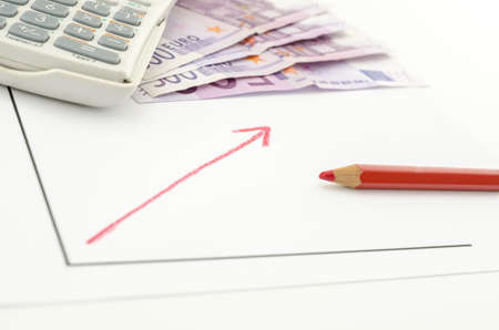 growing business: Growing business graph with red arrow with Euro banknotes and calculator in background.