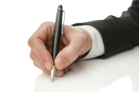 space to write: Closeup of businessman hand writing on copy space.