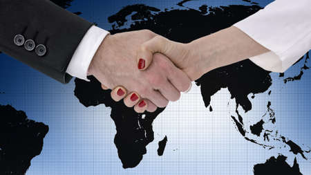 Business partners shaking hands over map of the world