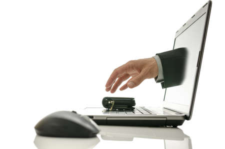 Hand coming out of laptop screen stealing wallet  Concept of internet theft  Stock Photo - 20015422