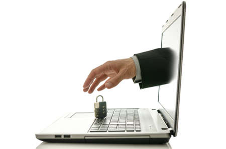 Male hand stealing padlock through laptop monitor  Concept of internet theft  Stock Photo - 20015451