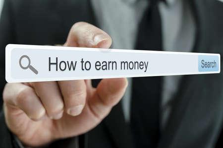 仮想画面上の検索バーで書かれたお金を稼ぐ方法 写真素材