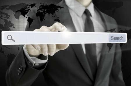 url virtual: Closeup of businessman pointing at search bar on virtual screen.