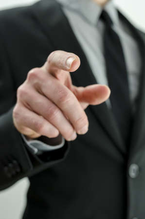 Closeup of businessman pointing finger at you. photo