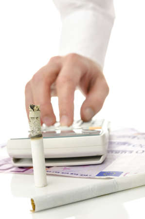 Money being burned away by smoking. Concept of unreasonable  money spending for harmful cigarette addiction. photo