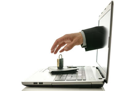 Male hand coming out of laptop monitor trying to steal ones wallet only to find it under padlock. Stock Photo - 20309345