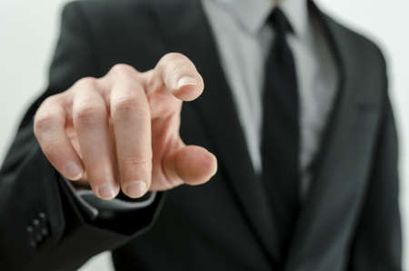 navigating: Closeup of businessman hand touching virtual screen.