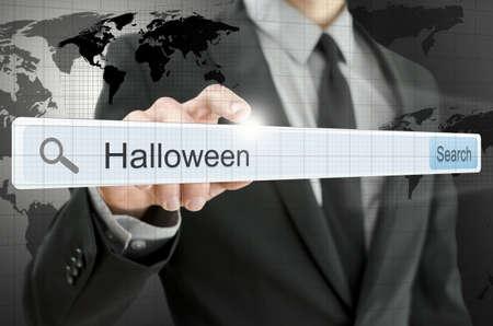 Word Halloween written in search bar on virtual screen. Stock Photo - 20309380