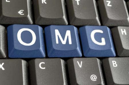 slang: Abbreviation OMG written with blue keys on computer keyboard.
