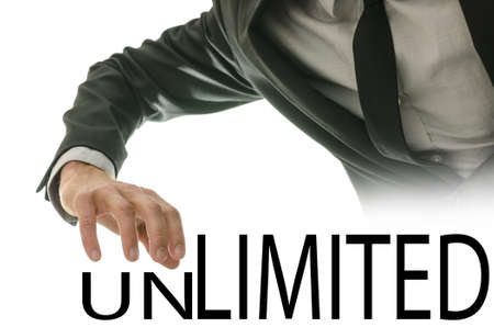 unlimited: Changing word Unlimited into Limited by pushing away letters UN. Stock Photo