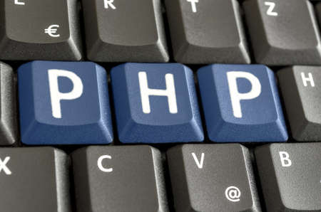 php: PHP written with blue keys on computer keyboard. Stock Photo
