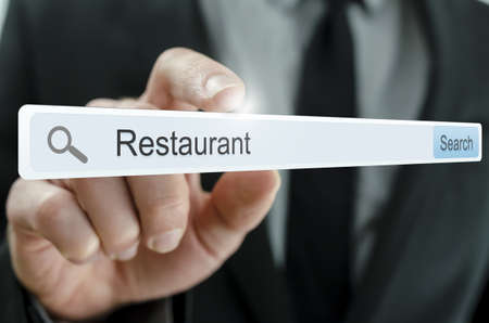 url web: Word Restaurant written in search bar on virtual screen. Stock Photo