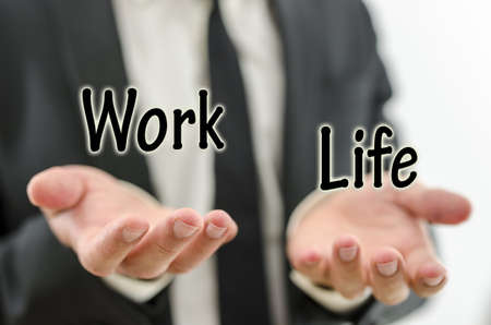 comparison: Business man balancing work and private life. Weighing priorities in life.