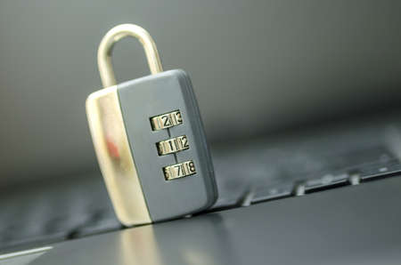 Closeup of padlock on laptop keyboard. Concept of online security. Stock Photo - 20428595