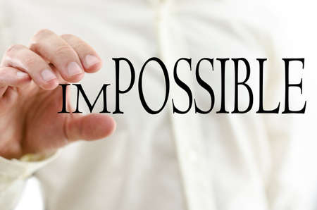 un: Changing word Impossible into Possible by minimizing letters un. Stock Photo