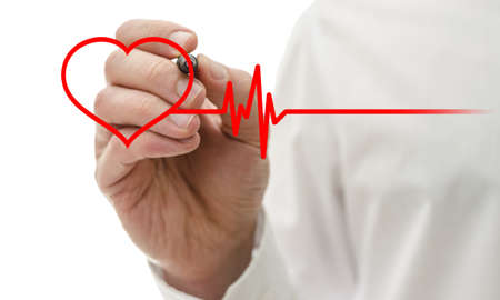 Male hand drawing heart and heartbeat symbol with red pen.