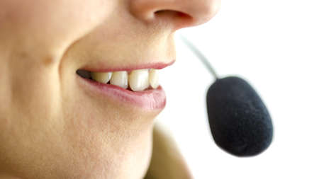 Closeup of mouth and microphone of young female call center operator  Stock Photo - 20906918