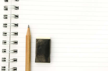 taking notes: Pencil and eraser on open notebook ready for student to start taking notes  Empty space ready for your text  Stock Photo