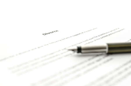 petition: Detail of Petition for divorce paper with ink pen on it.