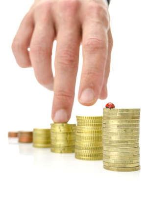 Growing stacks of coins with ladybug on the tallest one. Concept of growing savings. Stock Photo - 21068425