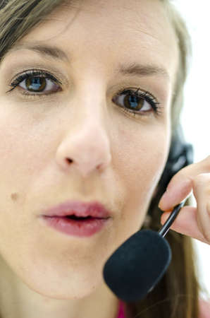 Portrait of young businesswoman with headset. Stock Photo - 20992322