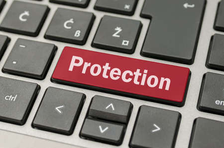 Protection written on red key on computer keyboard. Stock Photo - 21071016