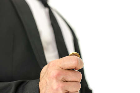 business dilemma: Closeup  of businessman hand flipping  a coin. Isolated over white background.