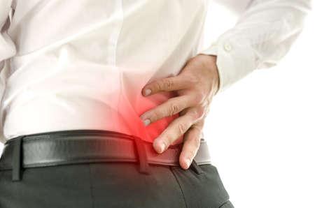 Detail van een mans terug met gelokaliseerde verf in zijn onderrug Stockfoto