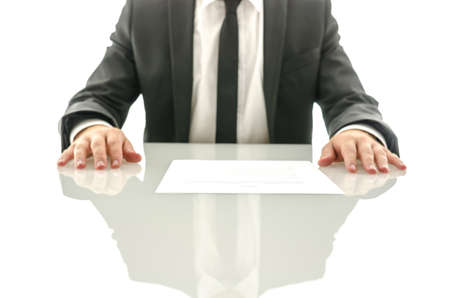 Determined business man with contract on his desk  Focus on a contract  photo
