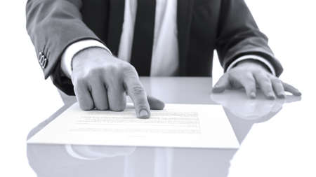 witness: Lawyer sitting at white desk showing his client to proof read and check a statement. Stock Photo