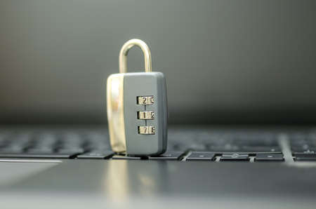 identity protection: Lock on laptop computer keyboard. Concept of internet security.