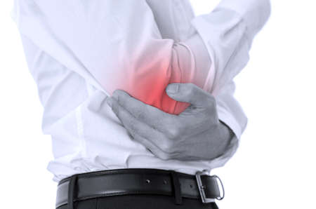 emphasized: Businessman holding his injured elbow. Painful area emphasized with red color.